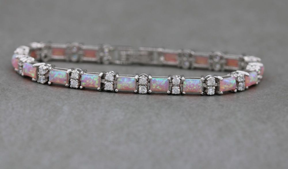 Sterling silver tennis bracelet with pink imitation opal