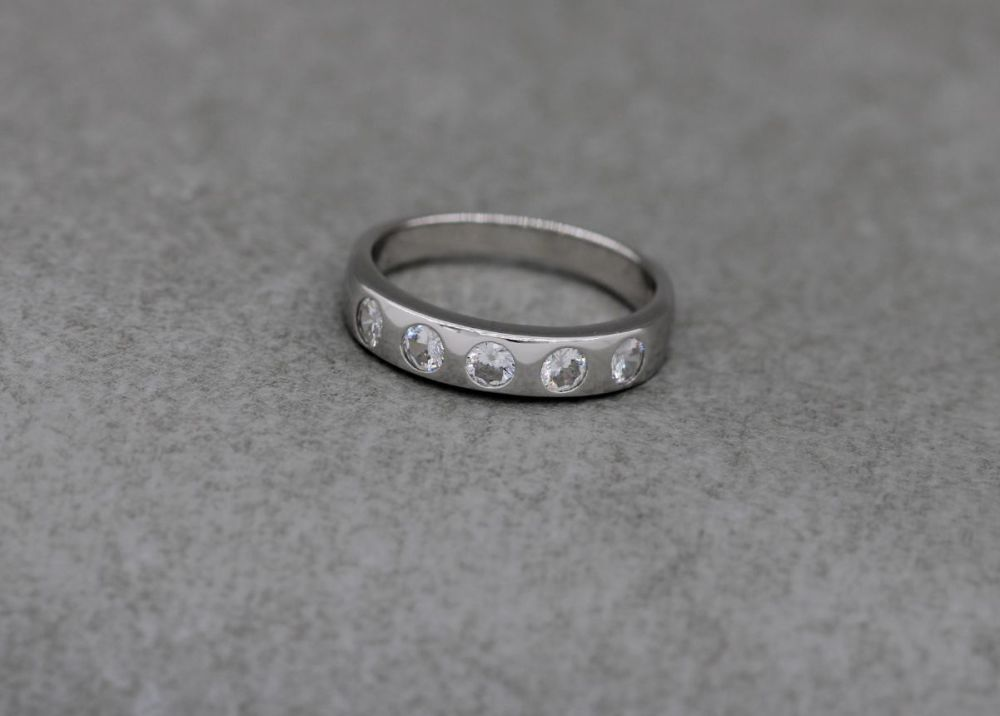 Sterling silver ring with five flush set clear stones