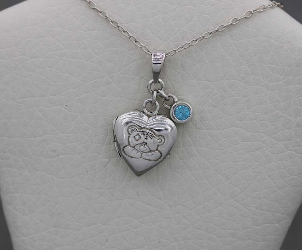Child's sterling silver 'Tatty ted' heart locket & blue stone charm