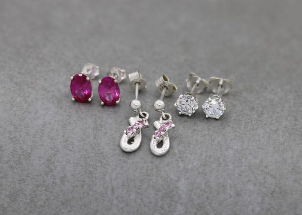 3 x pairs of sterling silver earrings; deep pink oval, classic clear & pale