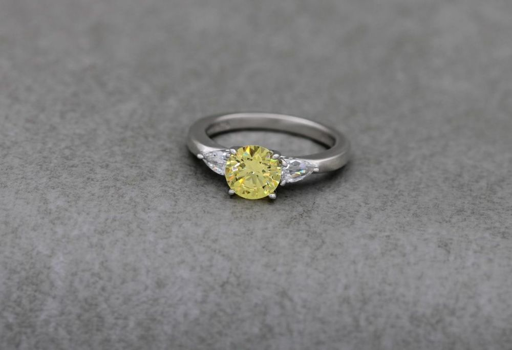 Sterling silver trilogy ring with yellow & clear stones