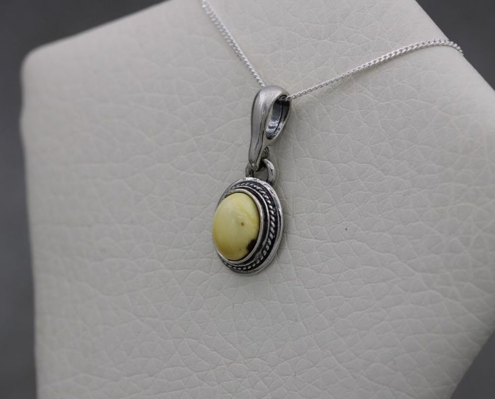 Small oval sterling silver & creamy lemon amber necklace