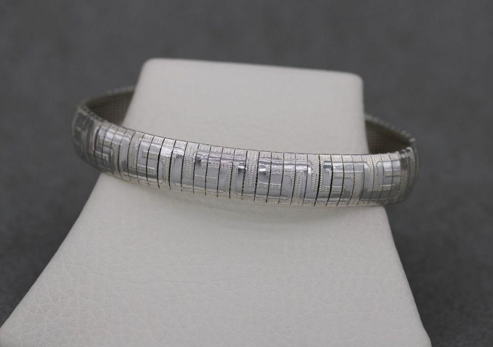 Sterling silver omega bracelet with a Greek key design