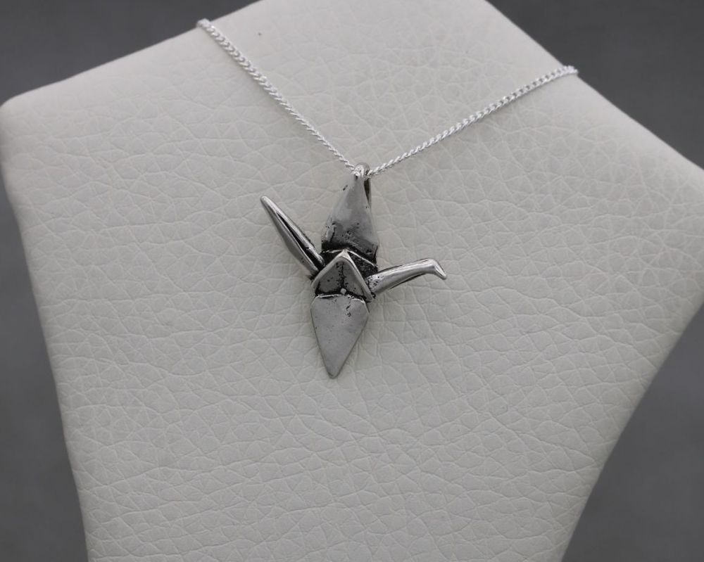 Small sterling silver origami bird necklace