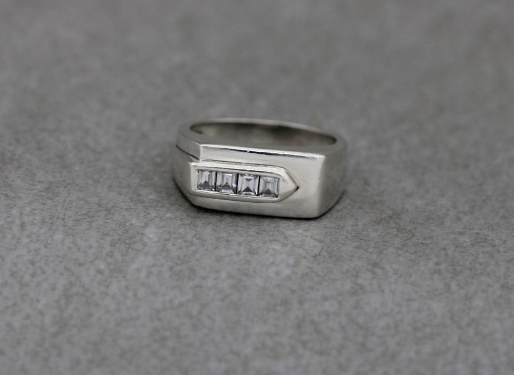 Bold asymmetric sterling silver ring with clear square stones