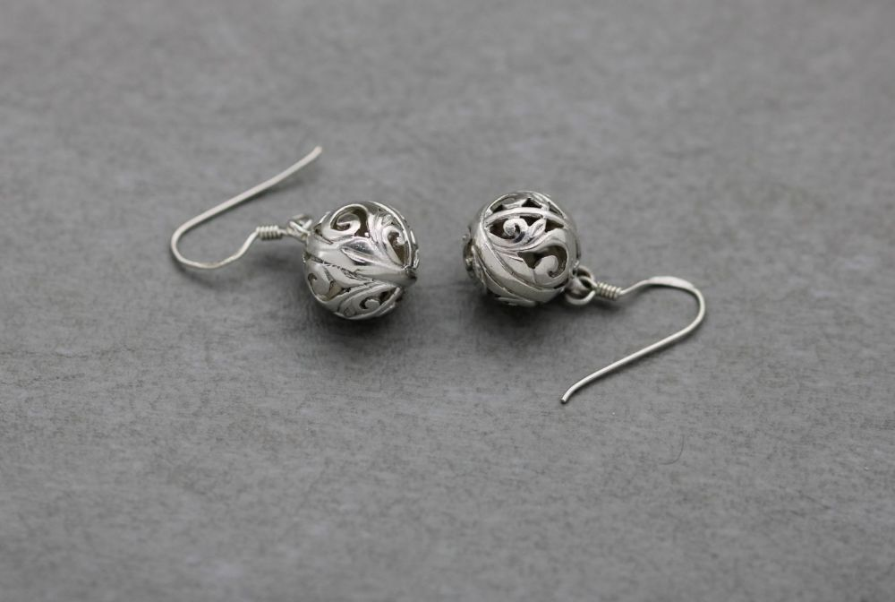 Decorative sterling silver cut-out sphere earrings