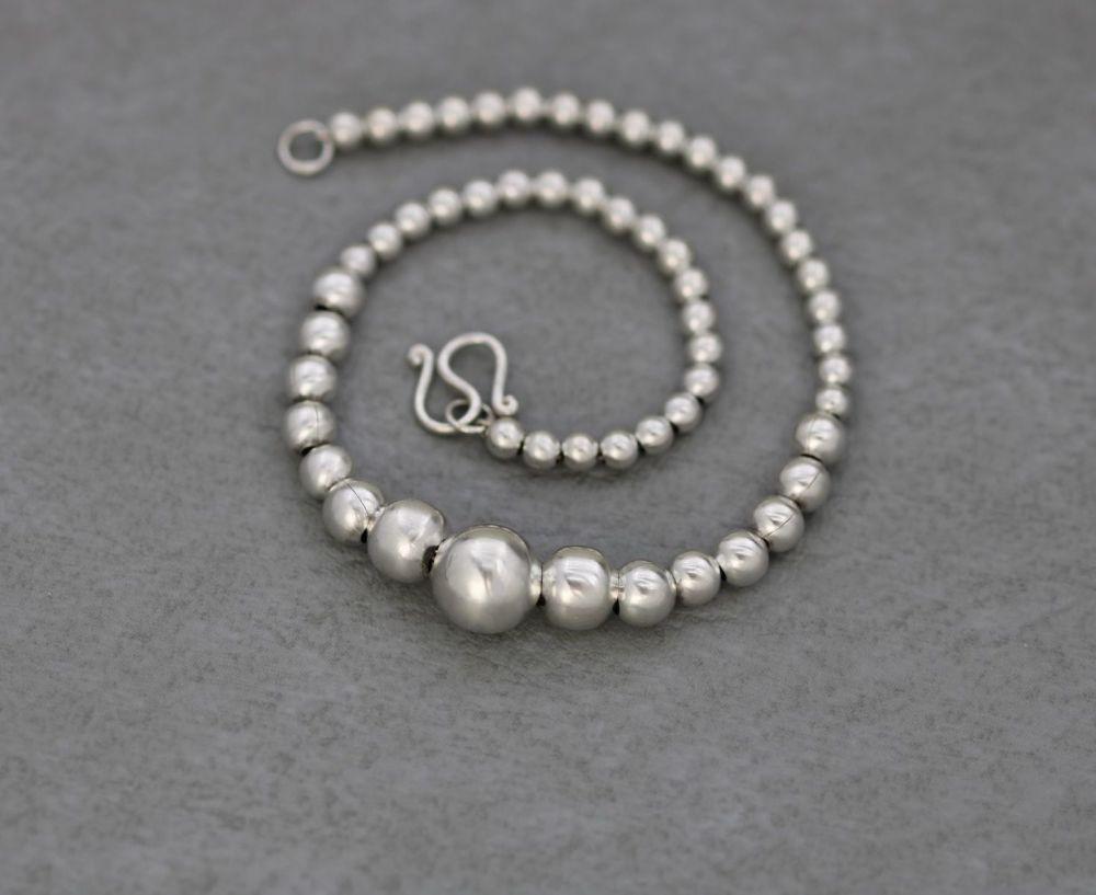 Sterling silver graduated sphere bracelet