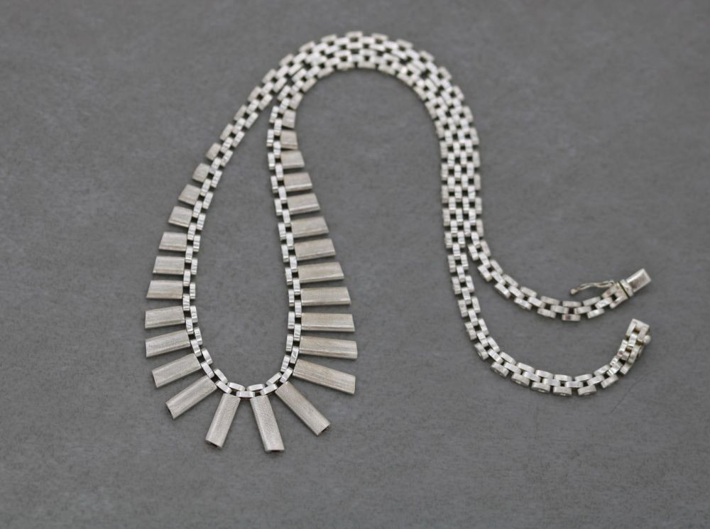 Sterling silver necklace with a textured fringe