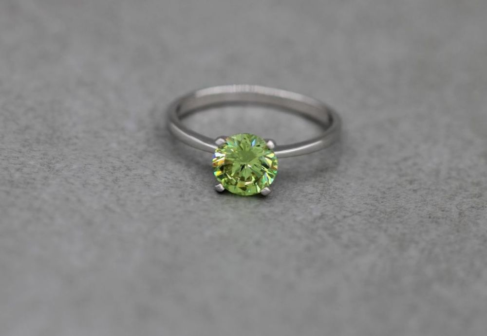 Sterling silver & faceted green stone solitaire ring