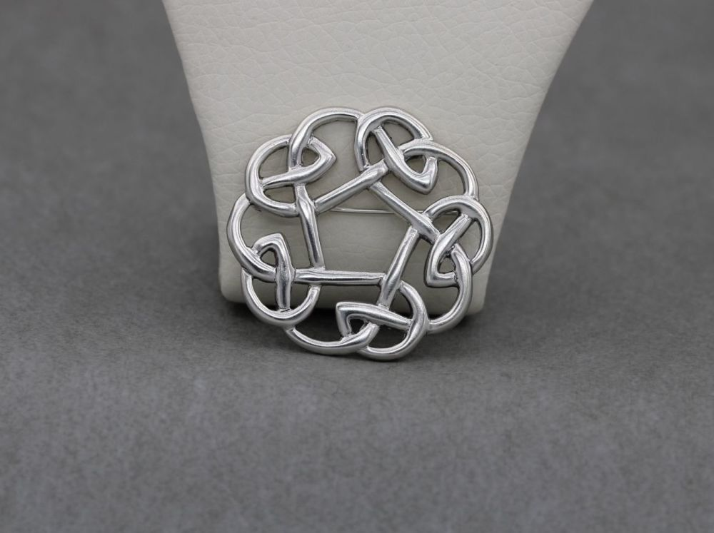 Circular sterling silver brooch with an infinity Celtic knot design
