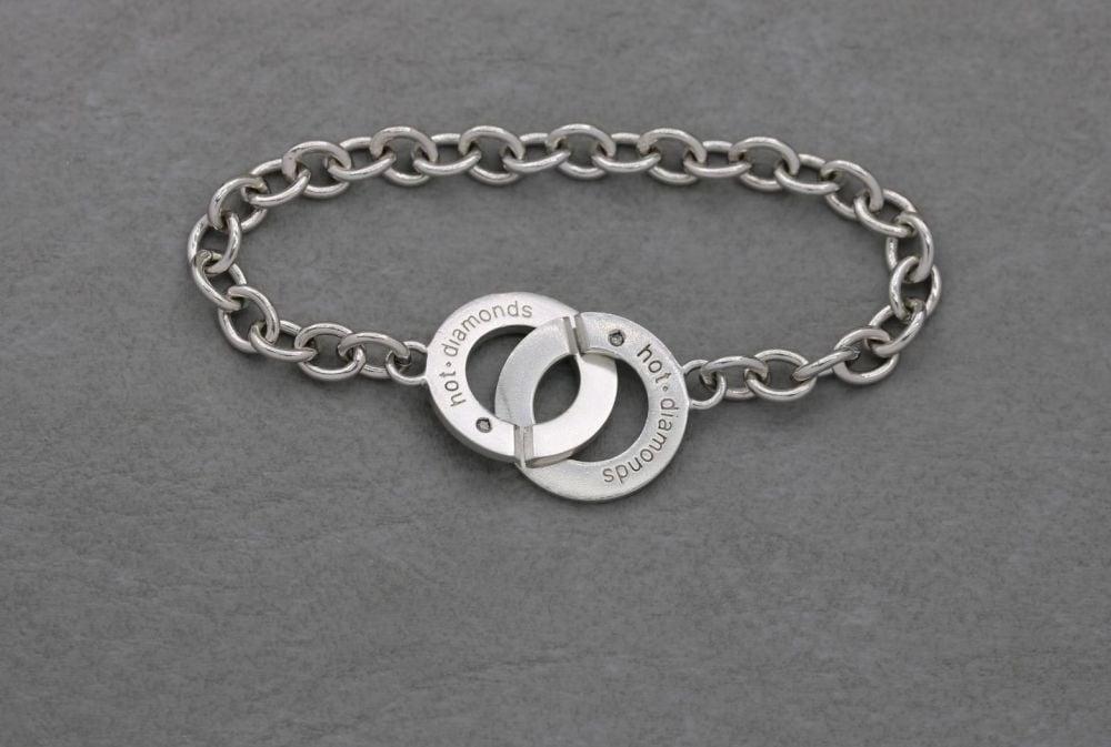 Sterling silver & diamond bracelet with an interlock clasp