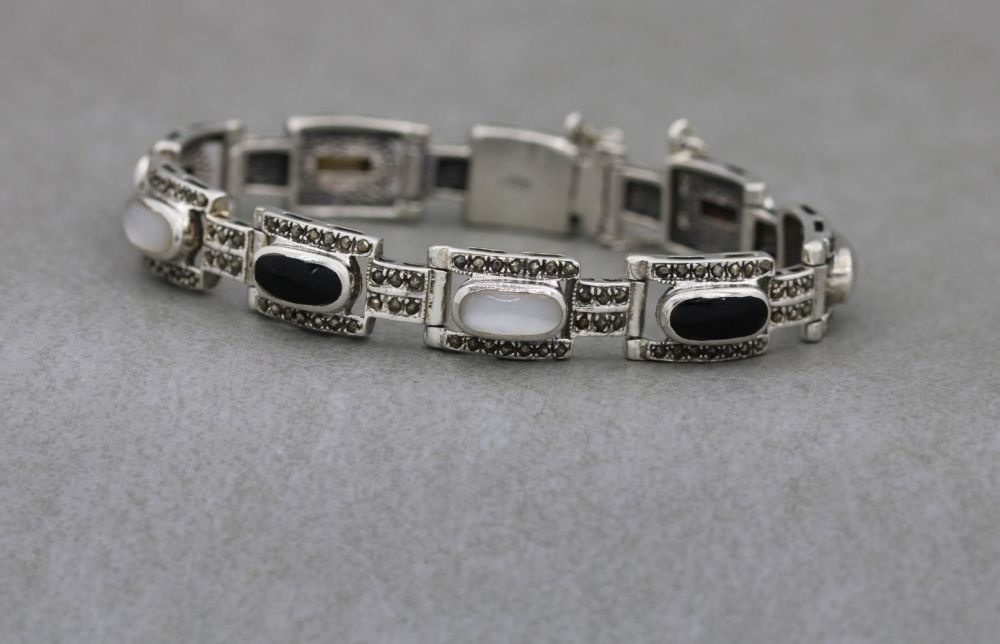 Sterling silver, marcasite, black onyx & mother of pearl bracelet with safe