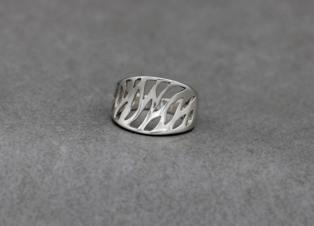 Sterling silver anticlastic ring with a cut out design