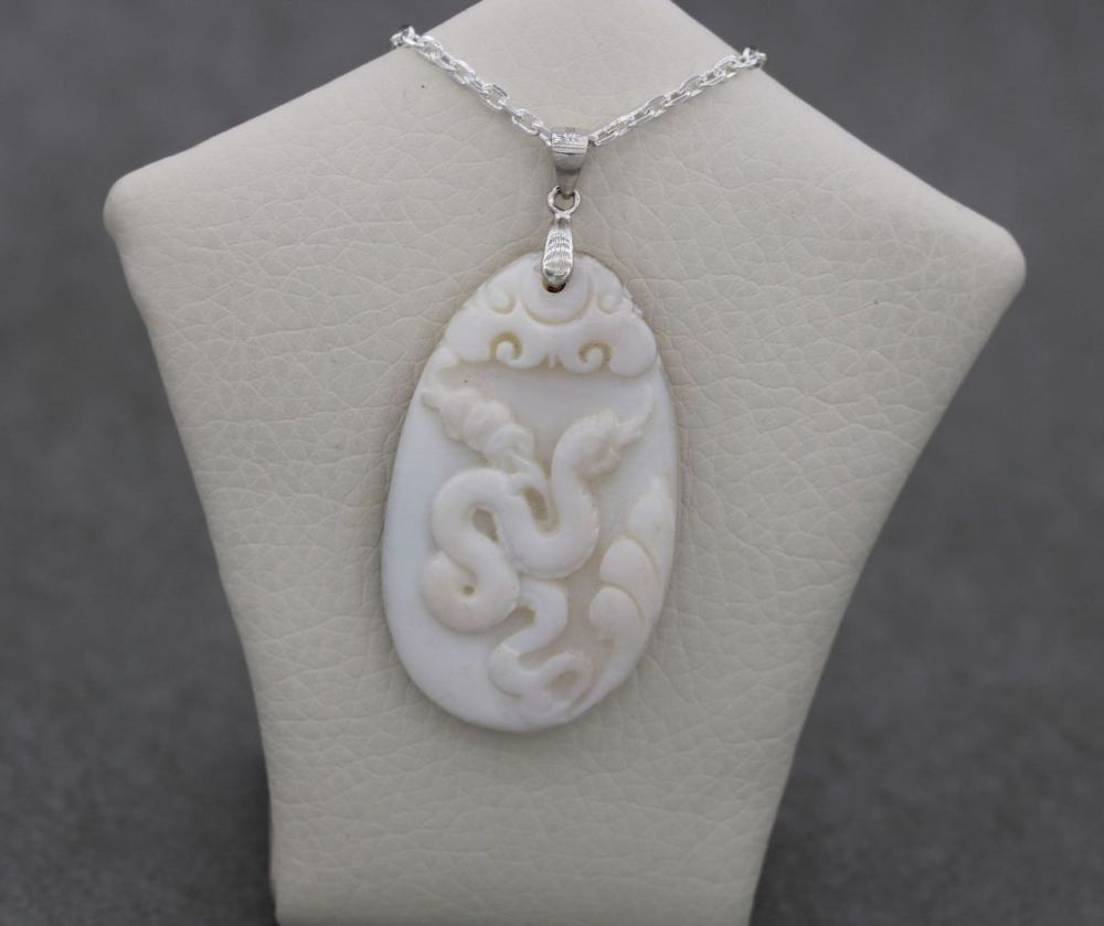 Sterling silver & mother of pearl necklace with a carved snake