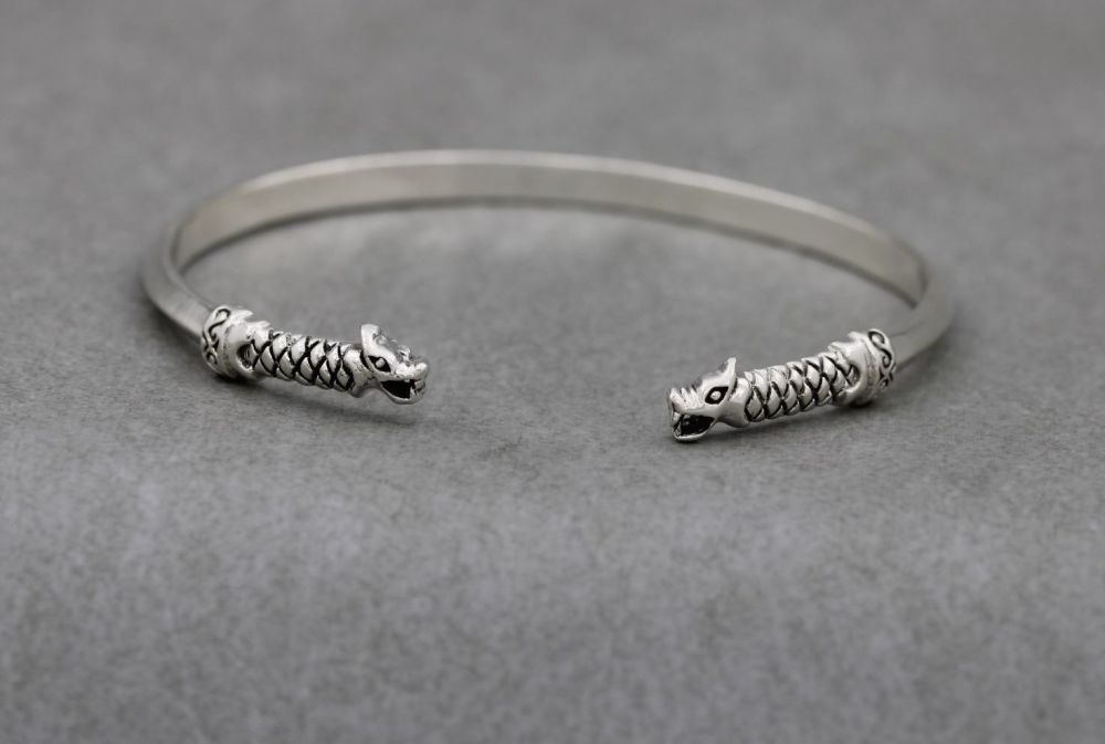 Solid sterling silver dragon tipped torque bracelet