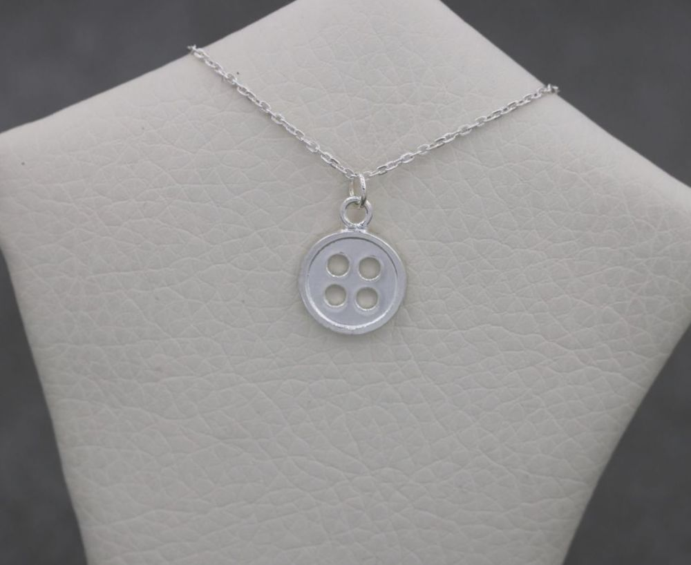 Tiny sterling silver button necklace