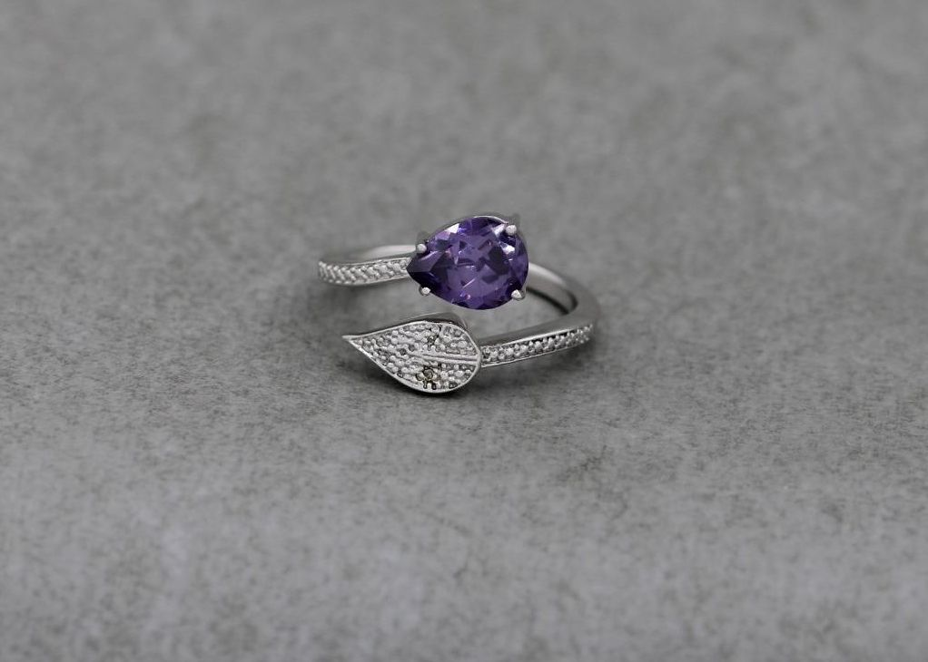 Sterling silver & amethyst coloured stone bypass ring