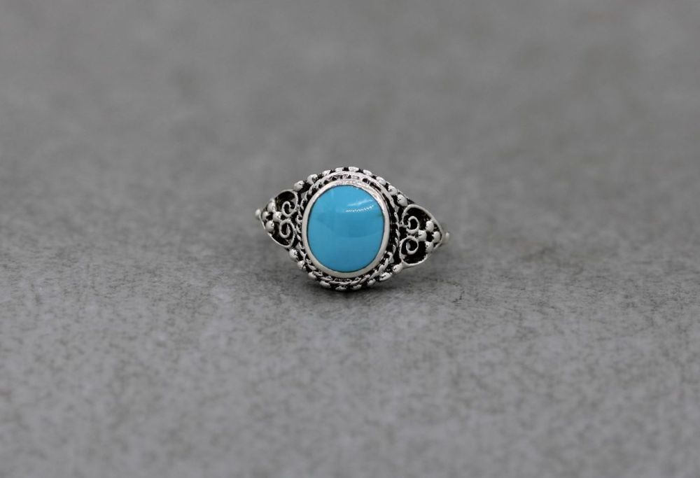 Sterling silver & light blue howlite ring with scroll & dot detail shoulders