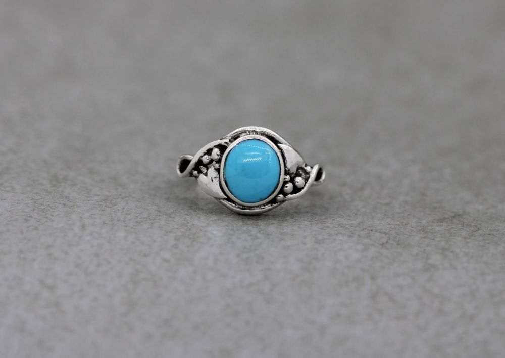 Sterling silver & light blue howlite ring with graduated dot & heart leaf shoulders