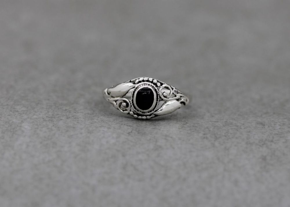 Sterling silver & black onyx ring with scroll & dot shoulders