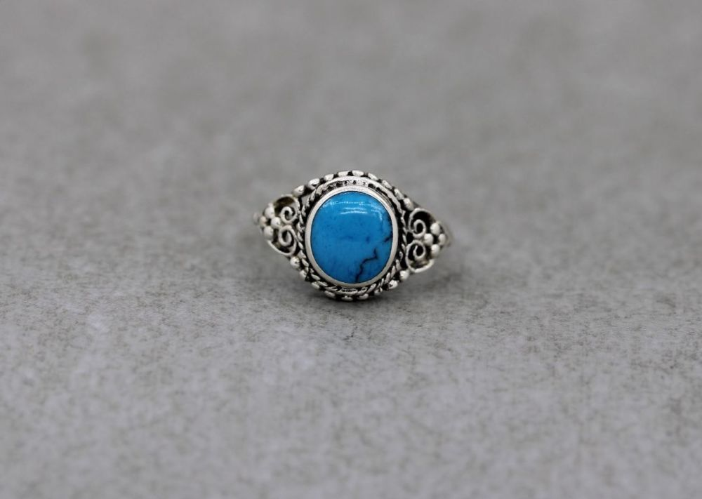 Sterling silver & blue howlite ring with scroll & dot detail shoulders