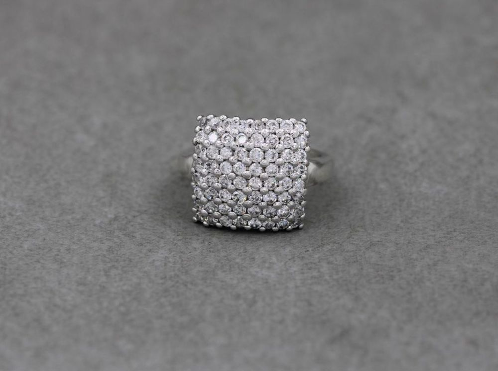 Sterling silver ring with a clear stone encrusted domed square