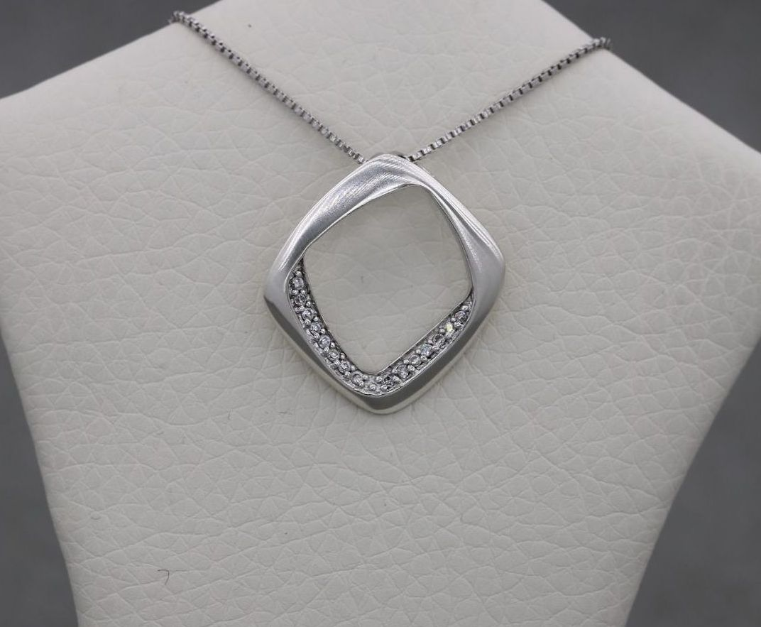 Sterling silver necklace with a clear stoned off-set square pendant