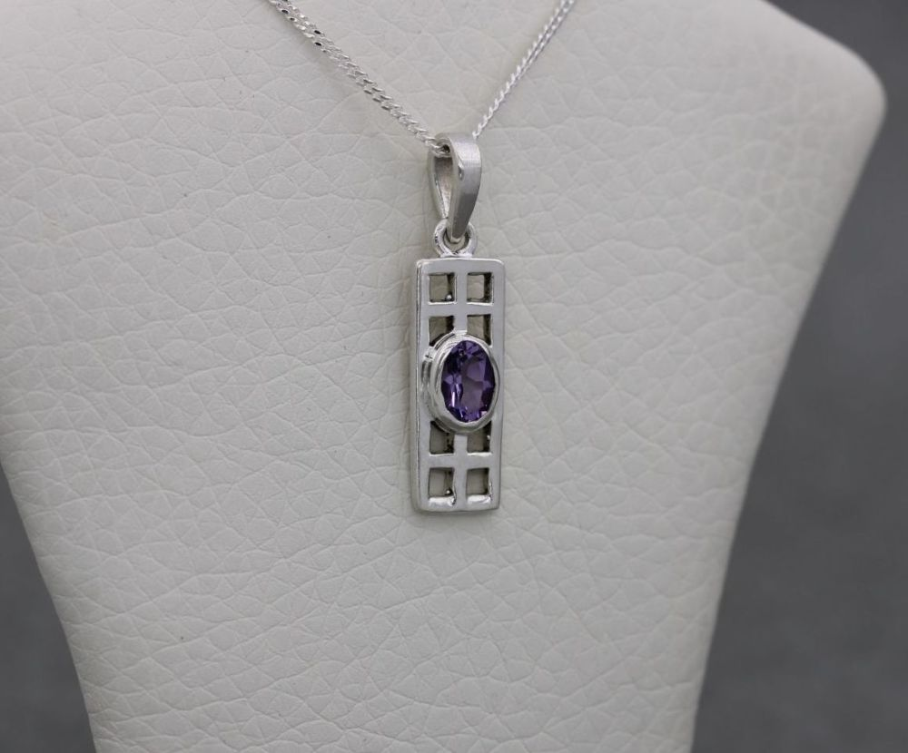 Small sterling silver & faceted purple stone necklace