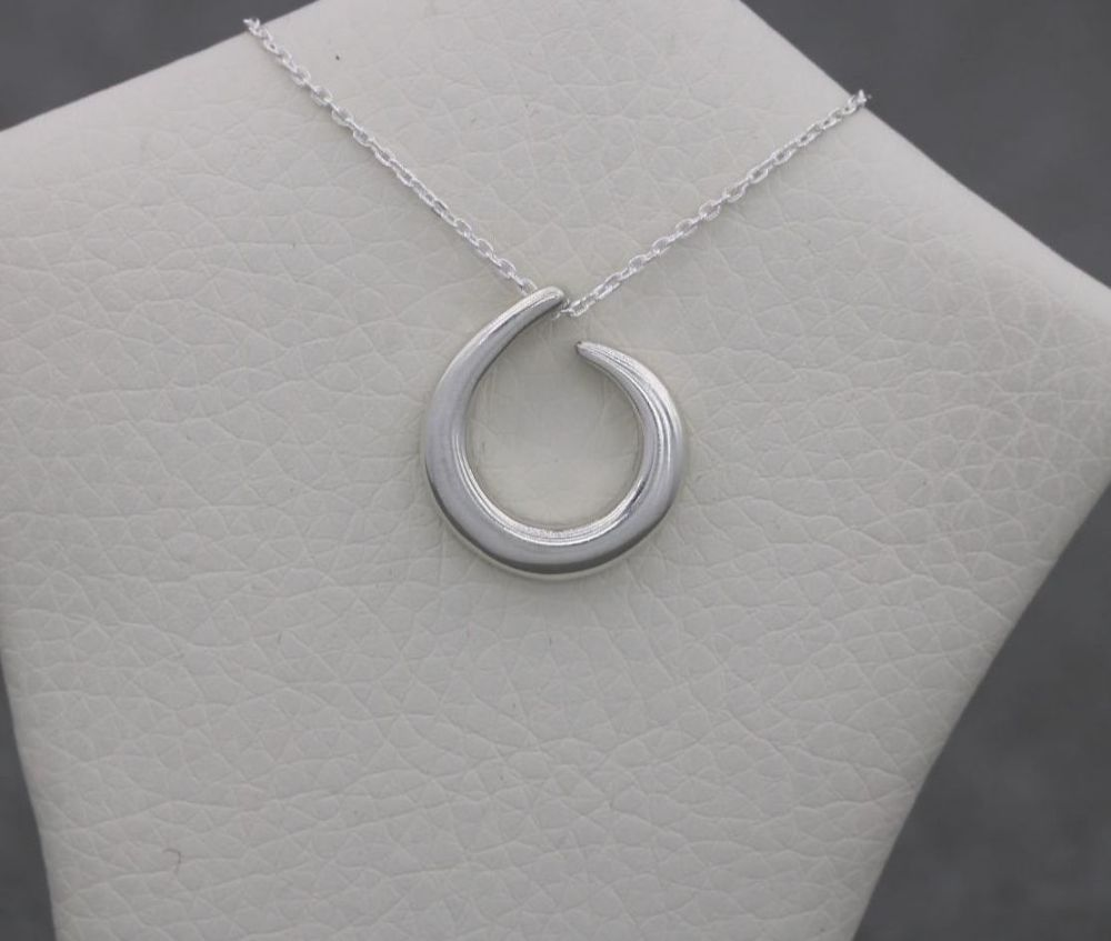 Small sterling silver curl necklace