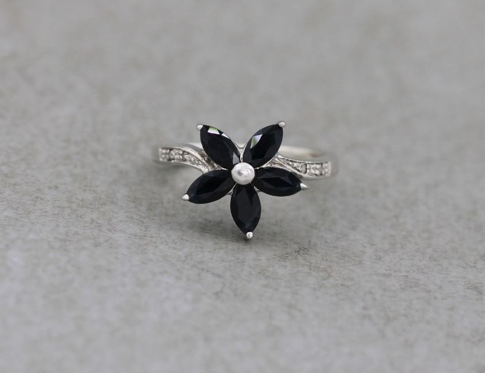Sterling silver flower ring with deep dark blue & clear stones