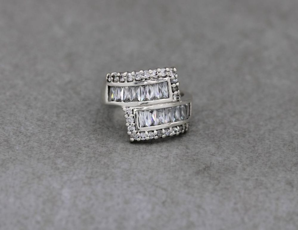 Wide sterling silver & multi-cut clear stone bypass ring