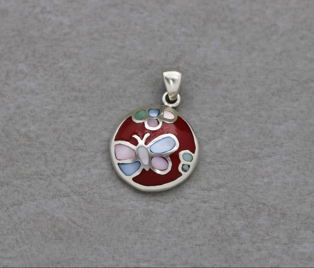 Small sterling silver butterfly pendant with dyed mother of pearl & red ena