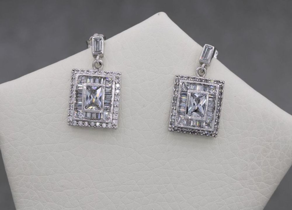 Rectangular sterling silver earrings set with multi-cut clear stones
