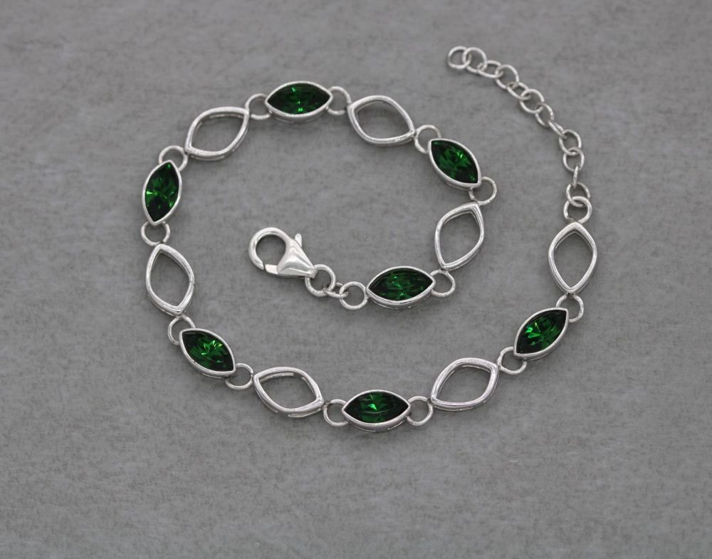 Sterling silver bracelet with green marquise stones
