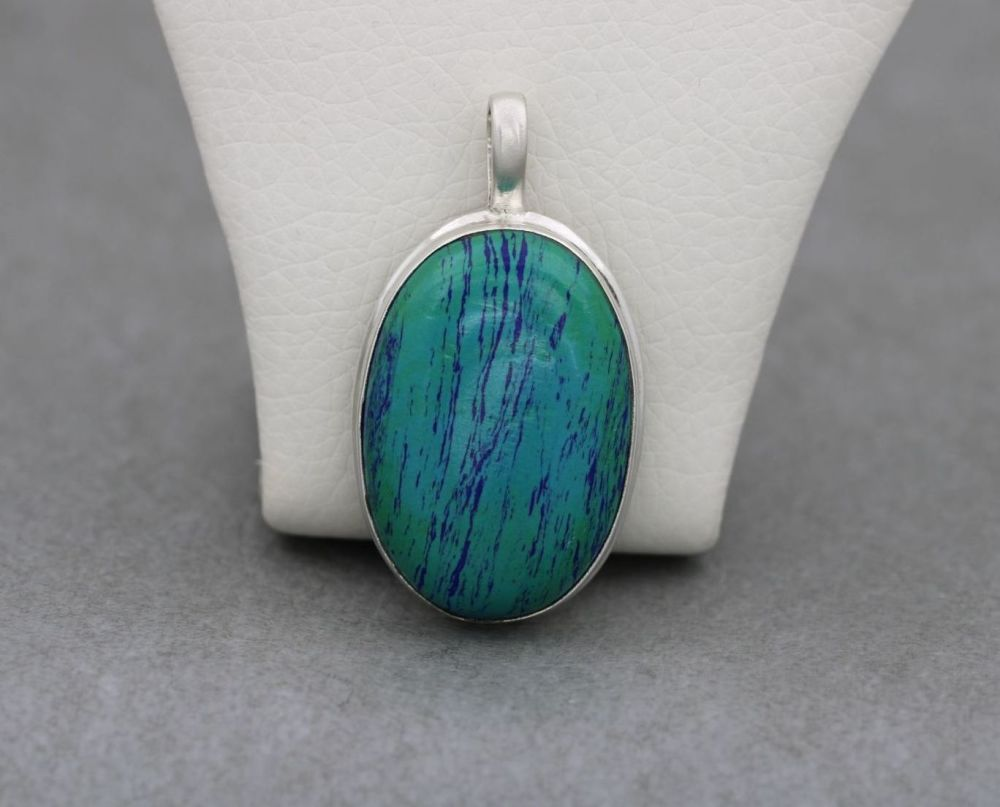 Large sterling silver pendant with an unusual blue & green stone