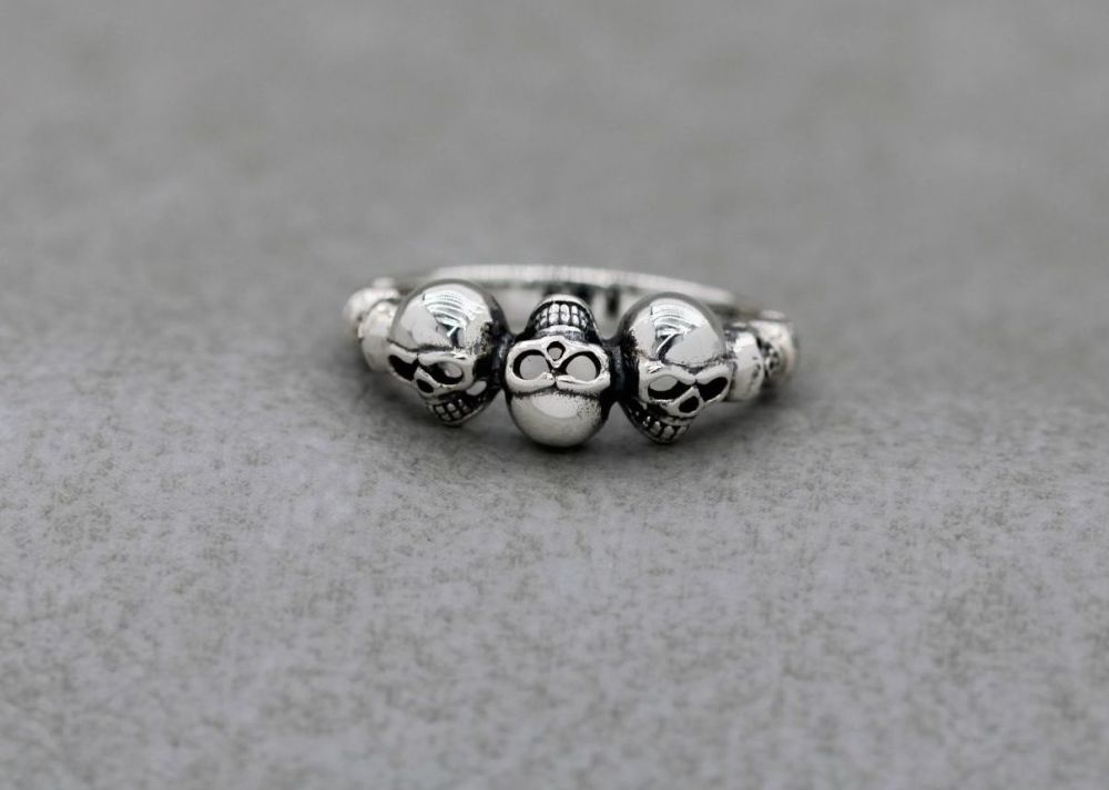 Quirky sterling silver skulls ring