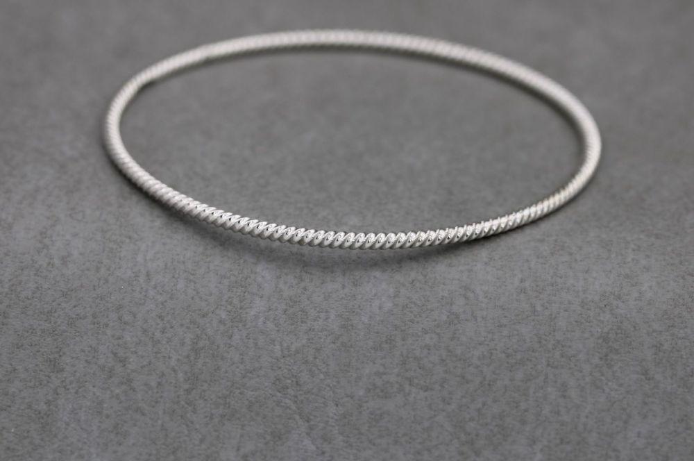 Handmade sterling silver tight twist bangle
