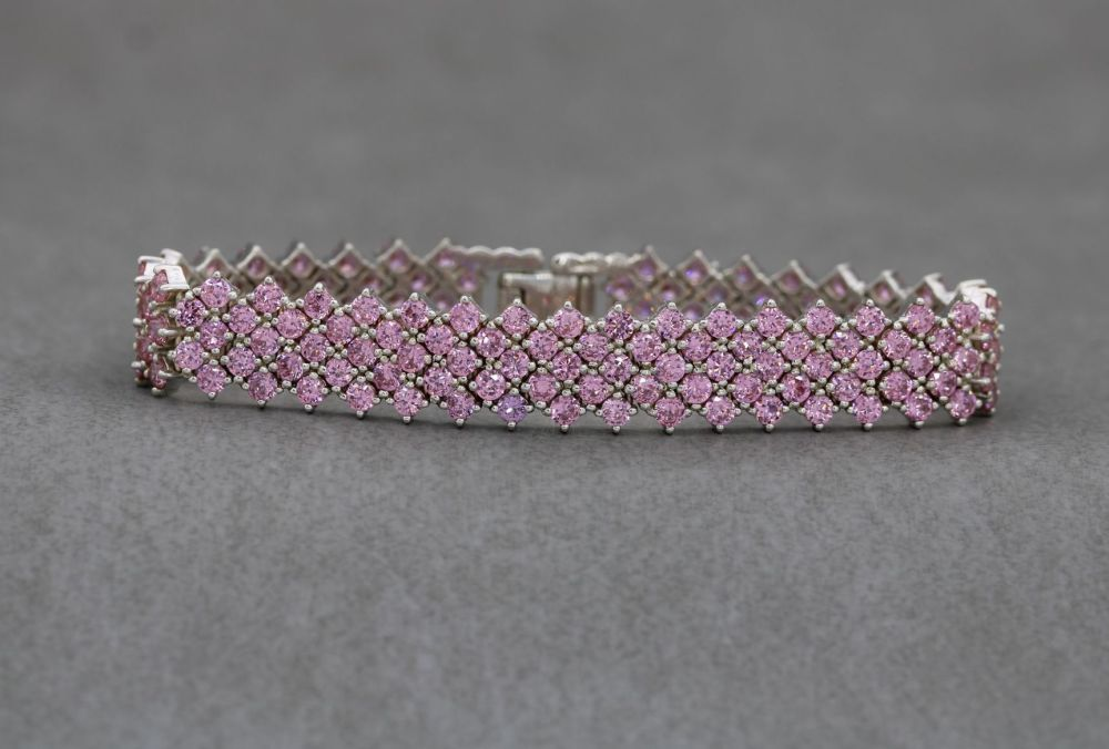 Heavy sterling silver & pink stone tennis bracelet with safety chain
