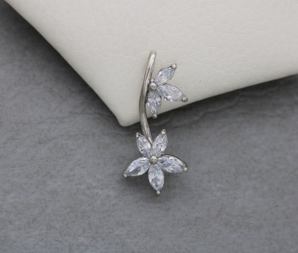 Floral sterling silver pendant with clear marquise stone petals