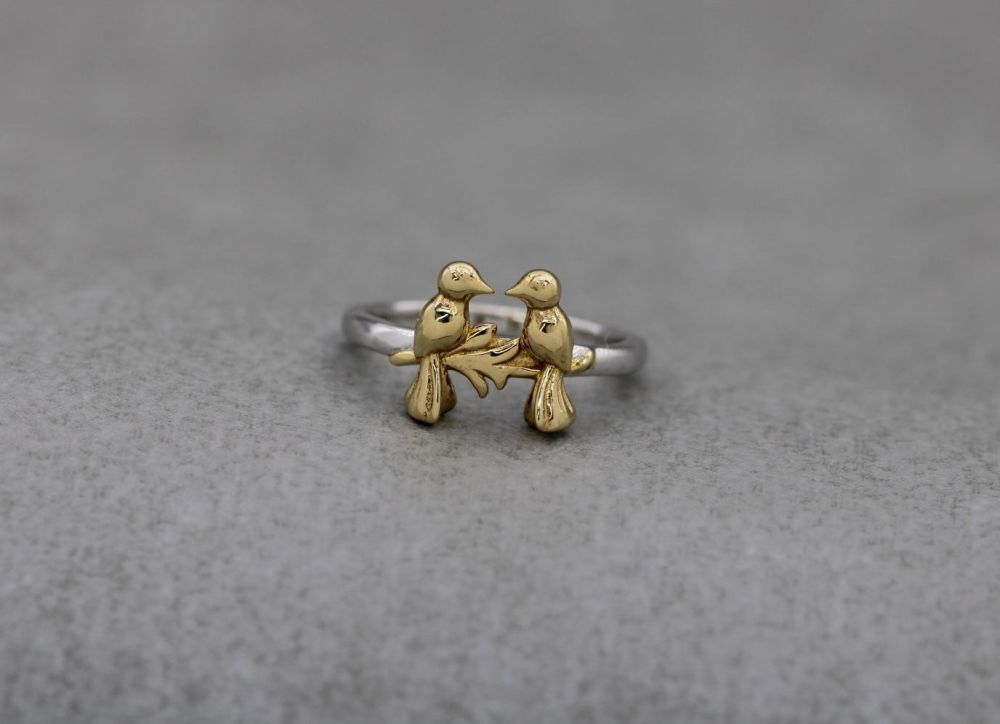 Sterling silver ring with two golden birds