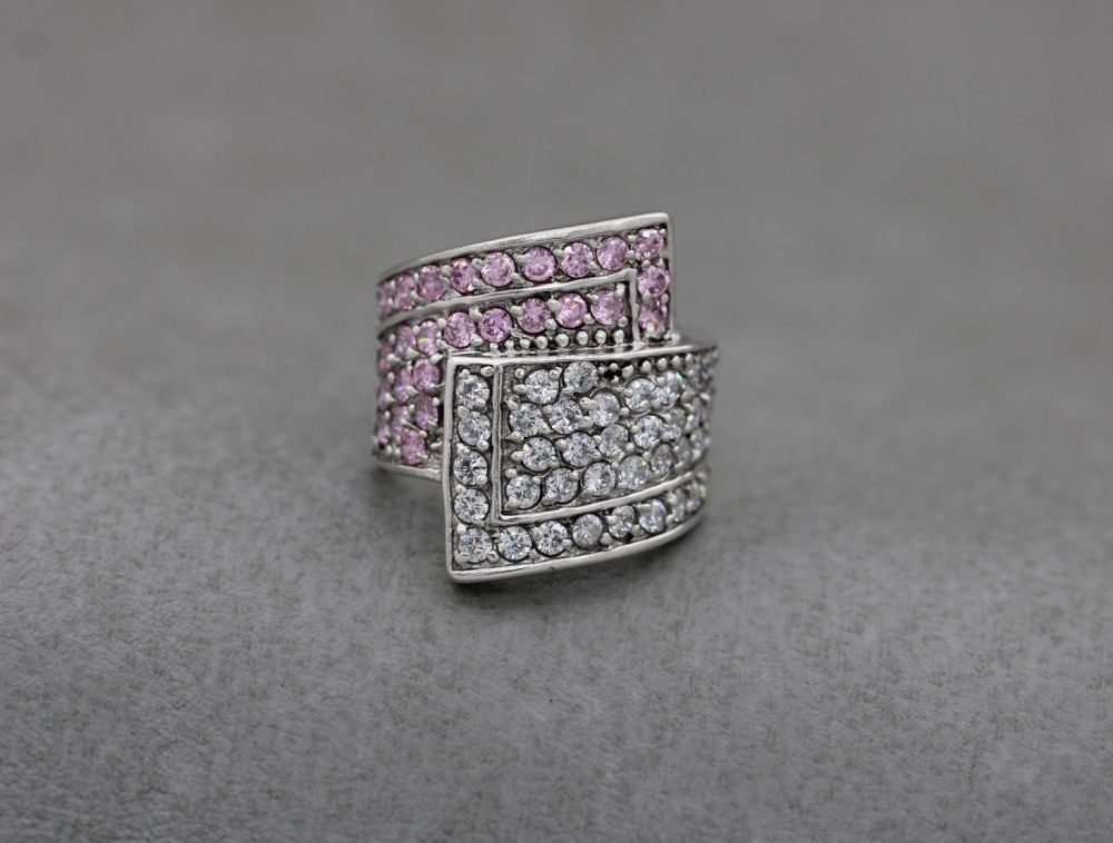 Long sterling silver bypass ring with pink & clear stones