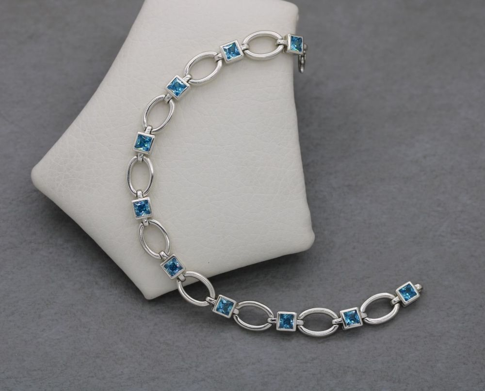 Sterling silver bracelet with faceted square blue zircon