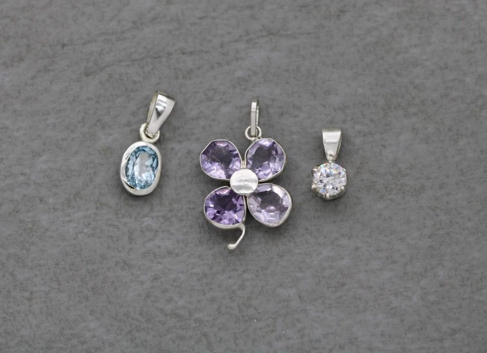 3 x sterling silver pendants; amethyst flower, blue oval & classic clear solitaire