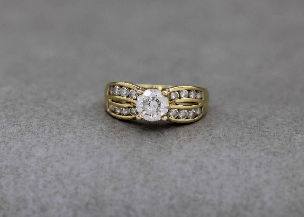 Gilt sterling silver & clear stone ring with fancy shoulders
