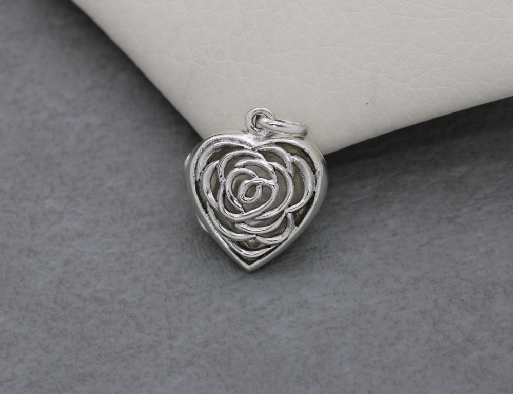 Sterling silver heart shaped floral cut-out locket