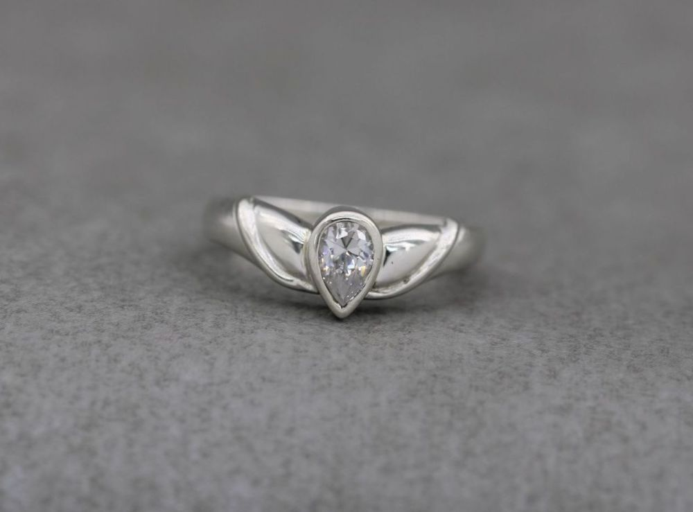 Fancy sterling silver & clear pear shaped stone solitaire ring