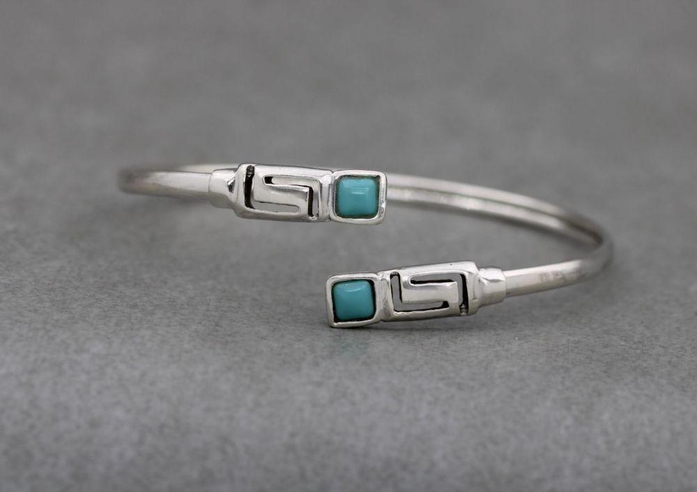 Sterling silver bypass bracelet with Greek key & blue stone detail