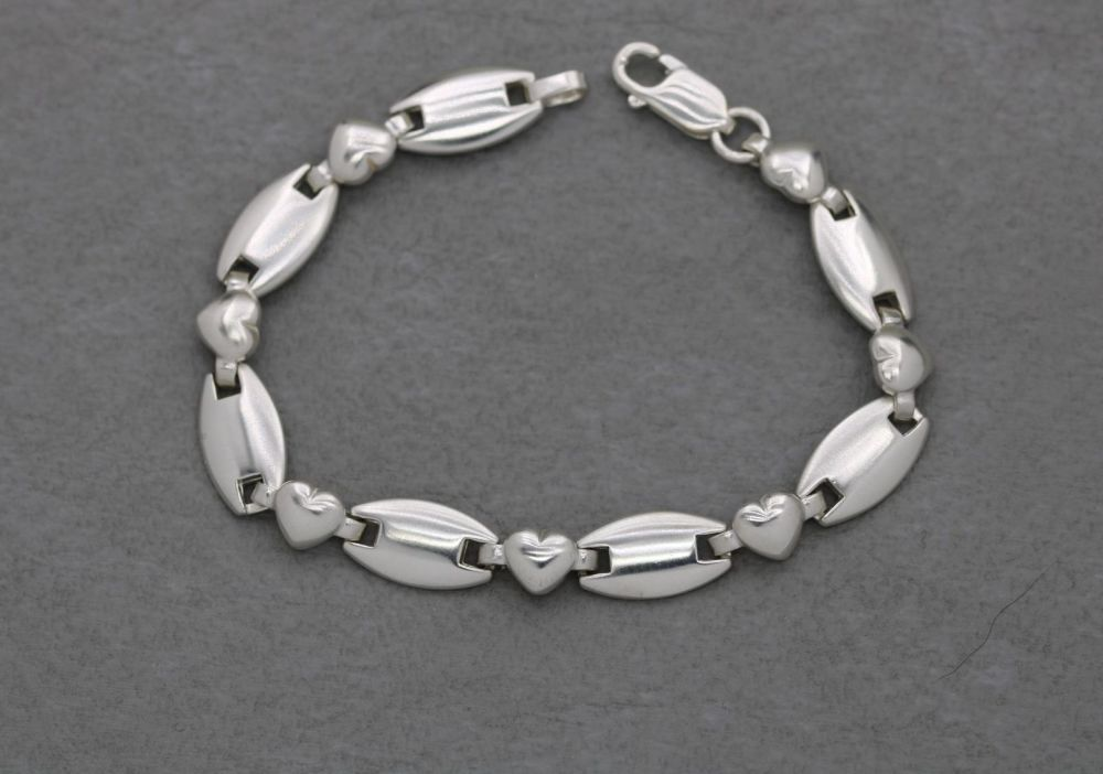 Sterling silver bracelet with domed hearts & ovals