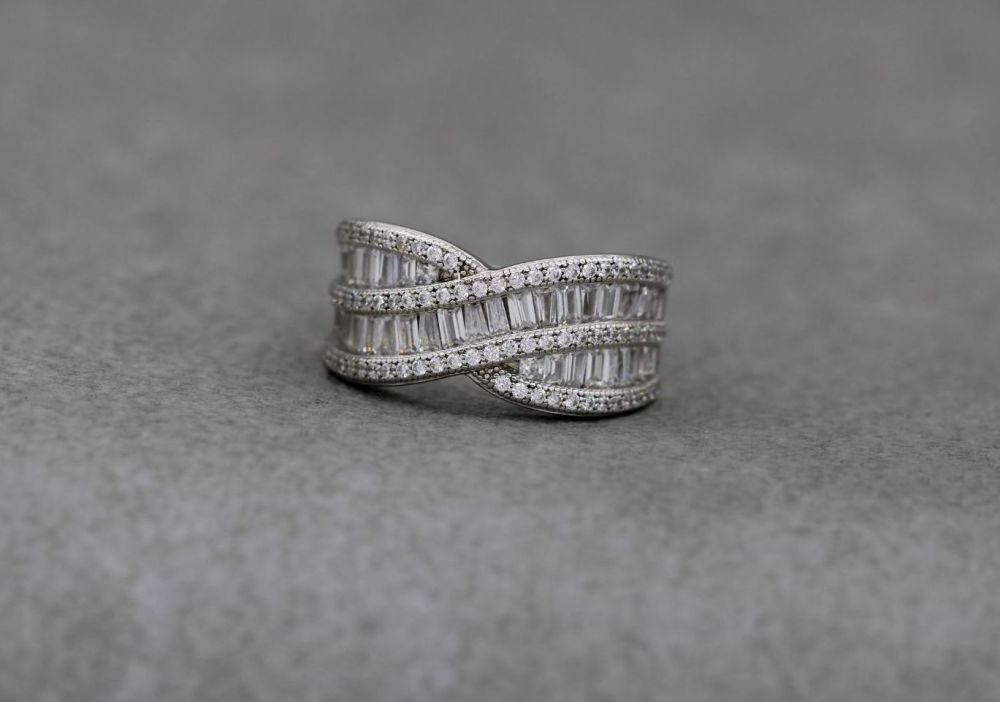 Elegant sterling silver ring with multi-cut clear stones