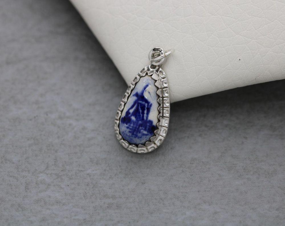 Small 835 silver pendant with a ceramic blue & white windmill scene